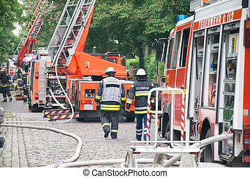 firemen with fire truck - german firemen with fire engine...