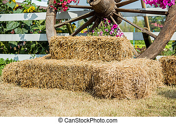 Straw bales with wagon wheels