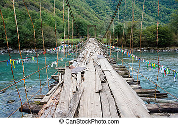 Suspension bridge across the river Bzipi, Abkhazia -...
