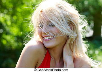 Joy - Image of cheerful blonde laughing on summer day