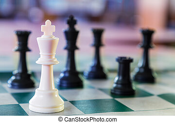 White chess king surrounded - White chess king alone...