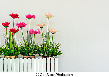 artificial flower in the wooden pot