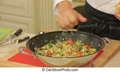 Asian stewed wegetables in a wok - Chef is serving asian...