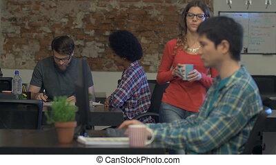 People working office desk drinking coffee talking...