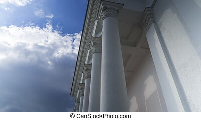 Classical white colonnade against cloudy sky 4K time lapse