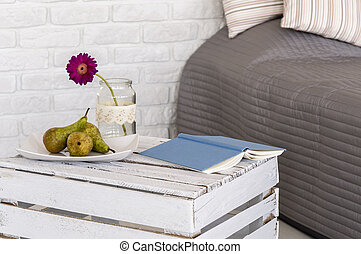 Pleasure of resting in bed - Part of a bedroom with bed and...