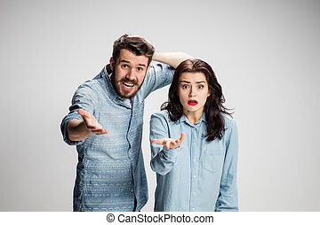 The business man and woman on a gray background