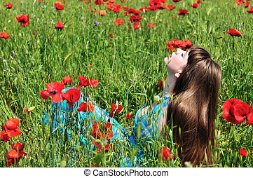 romance in field - longhaired romantic young woman resting...