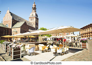 Evangelic -Lutheran cathedral in Riga Cafe on the square in...
