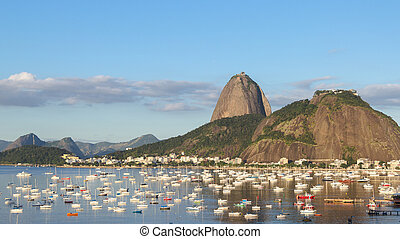 Afternoon in Guanabara Bay Urca Mountain and boats -...