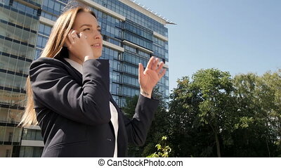 Portrait of Business Woman Making a Phone Call Outside Business Center