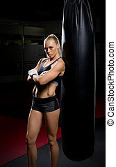 Kickboxer woman in gym - Young kickboxer woman in gym