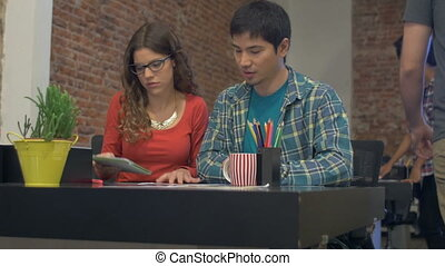 Asian Business man caucasian woman using tablet computer working office desk
