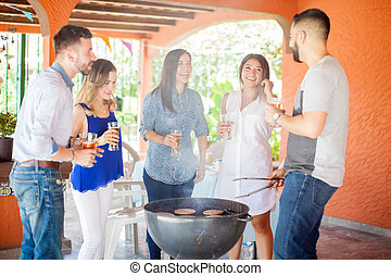 Group of friends having fun at the barbecue