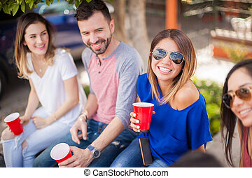 Cute woman spending time with some friends - Beautiful young...