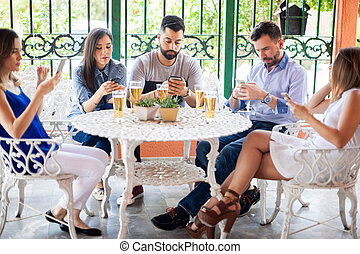 Friends checking over their smartphones