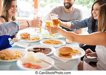 Group of friends with beer and burgers