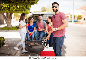 Good looking man cooking in a barbecue