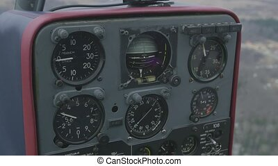 View at control panel of helicopter in moment of flight Day...