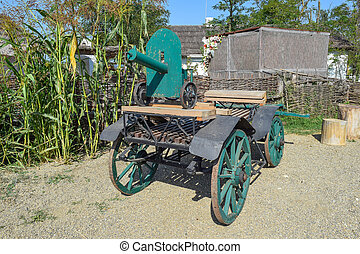 Green fake ancient gun on a cart. Decorative objects.