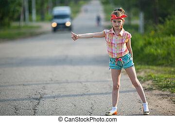 Little girl hitchhiker standing - Little funny girl...