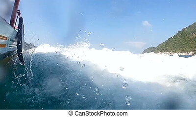 Riding on a boat in sea with waves Shooted at action wide...