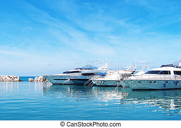 Yacht dock - View of the boat at the pier on sunny summer...