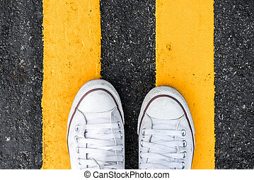 Top View of Sneakers from above sneakers standing at yellow...