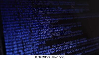 Html code on screen - Blue html code sliding on black screen