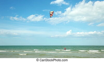 Kitesurfing in the sea - People learning how to use...
