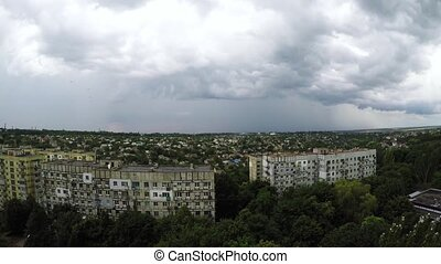 Fast moving dark gray rain clouds time lapse against the...