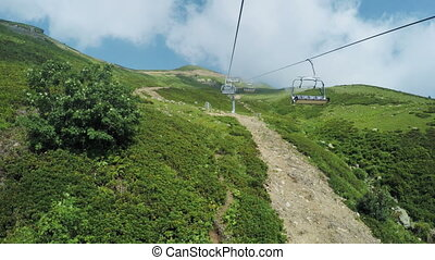 Lifts in mountains in summer - Fast shooting clouds and...