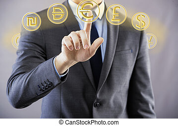 Man pressing buttons with different currencies