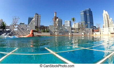 Man In Swimming Pool On The Roof