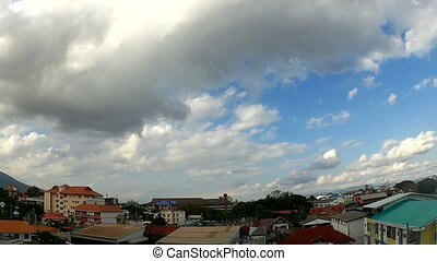 Time-lapse: sky over the city - Time-lapse: fast moving skys...