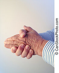 Man clasping his hands