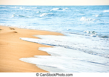 Long beach with sand and sea water