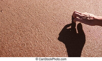 Woman Hand Paint Heart on beach Sand