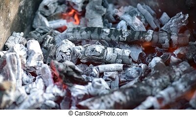 Glowing charcoal in barbecue grill - Close view at glowing...