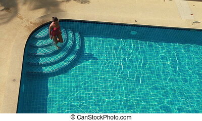 Swimming Pool And Woman - Woman In Red Swimwear Swimming In...