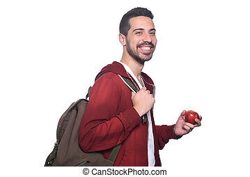 Portrait of young latin student with an apple and backpack .