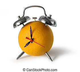 Fresh orange fruit alarm clock on white background