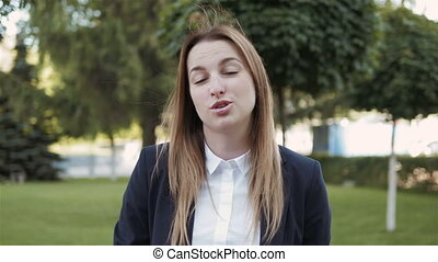 Young Frustrated Business Woman Shouting on Camera Outdoors,...