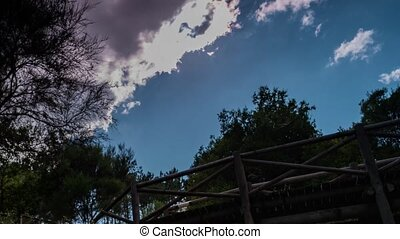 Timelapse of clouds over a wooden b - Timelapse of clouds...