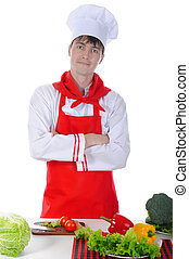 chef in uniform standing at the table