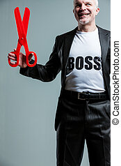 Happy mature boss man with large scissors - Happy mature...