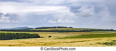 Wide landscape with wind turbine in the Eifel, Germany
