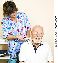 Senior Man Gets Ultrasound - Senior man getting ultrasound...