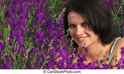 Girl is among the purple flowers