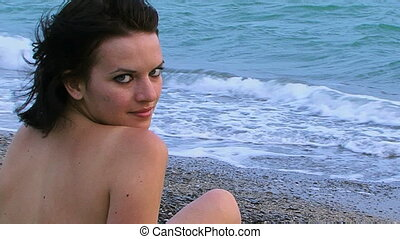 Girl sits on the sea - A beautiful girl sitting on the...